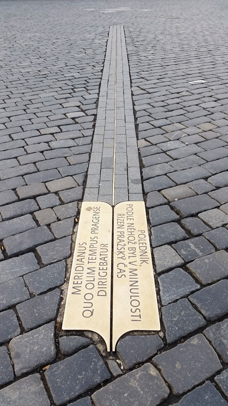 Prague Meridian marker plate in both czech and latin lined up on the old marian column marker