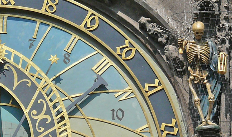 prague astronomical clock showing detail of the star and the skeleton