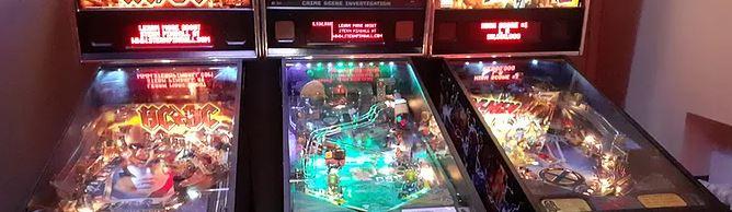 three pinball machines