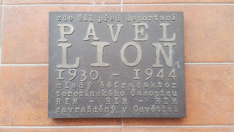 plaque on a wall in prague dedicated to pavel lion 1930-1944
