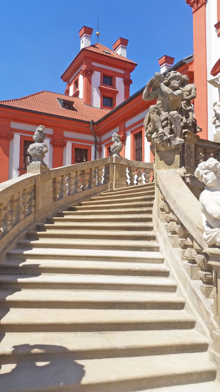 detail of a baroque stone staircase at the prague troja chateau