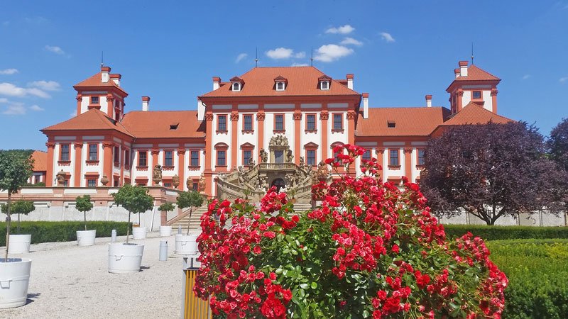 17th century baroque style troja chateau with roses in foreground