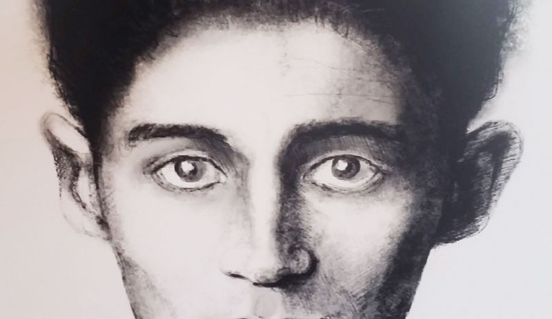 a black and white artistic sketch of the face of franz kafka