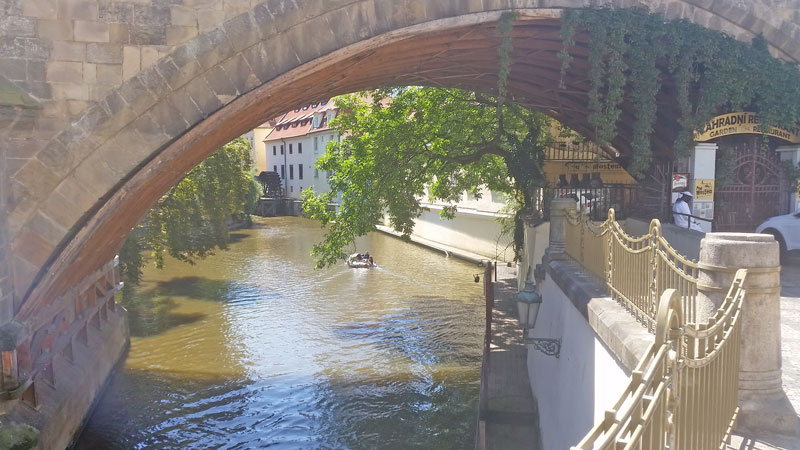 the area of the vltava river flowing under the charles bridge from the water wheel is called little venice