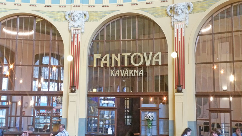 sign on the art nouveau fanta kavarna at prague main train station