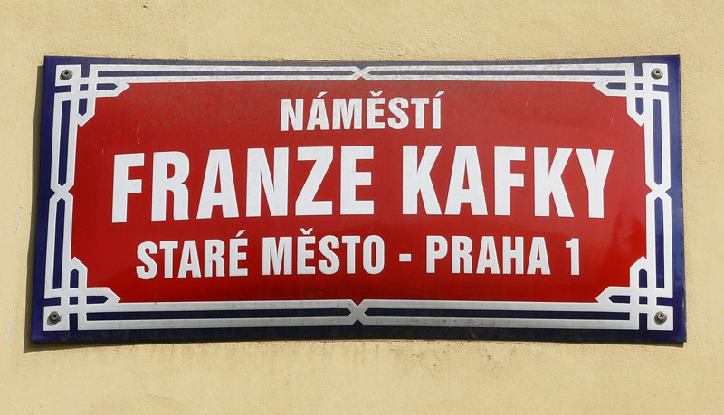 a street sign in old town prague called namesti franze kafky which translates as the square of franz kafka