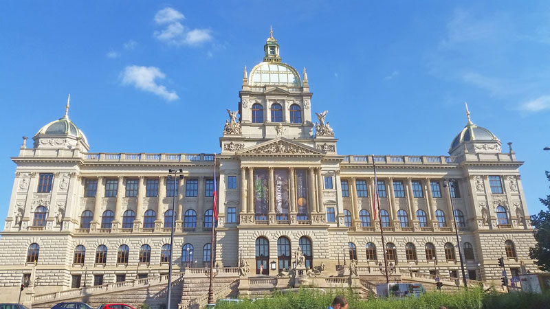 prague national museum at the top of wenceslas square in the sunshine with blue sky