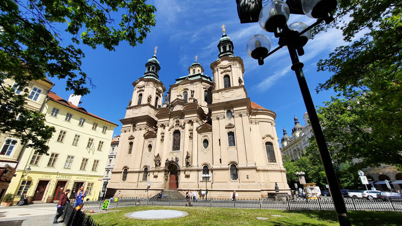 Scene picture of Prague ST Nicholas Church Old Town viewed from the little park
