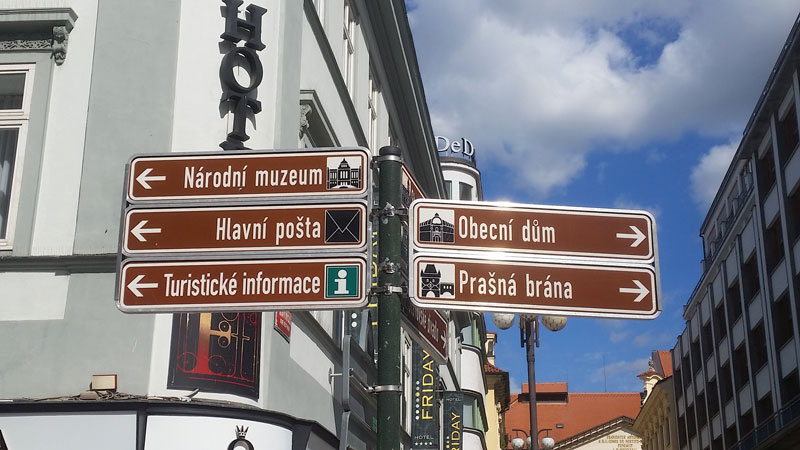 prague tourism sign posts in the new town