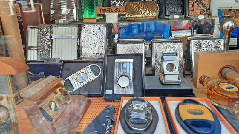a selection of cigarette cases and cigar cutters in a prague trafika or tabak