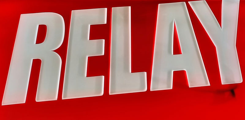 the word relay on a red background is the sign of a trafika or tabak in prague