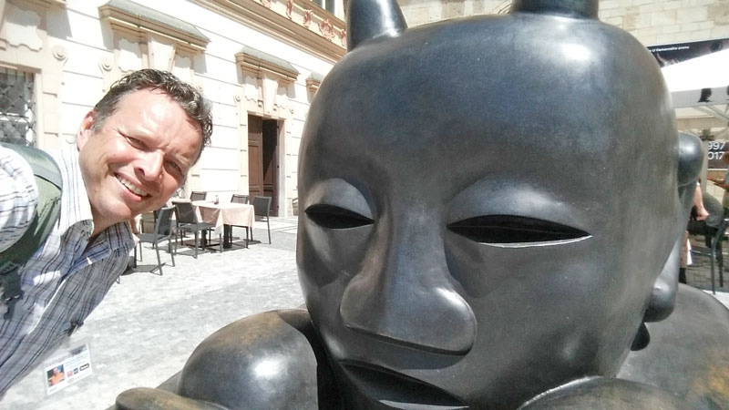 jaroslav rona bronze sculpture sitting devil on the old town square in 2017