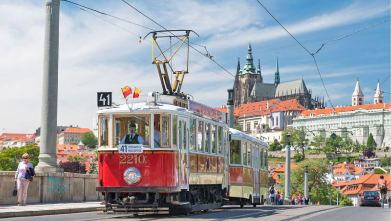prague historic tram 41 on manes bridge with prague castle in background