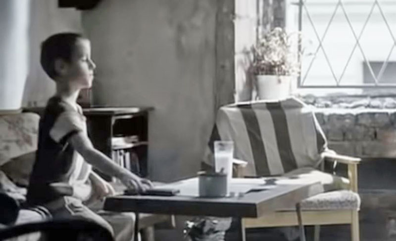 the scene from the linkin park video from the inside where the boy is sitting in the apartment