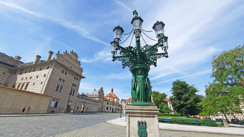 one of the original 19th century prague gas lamps in front of prague castle