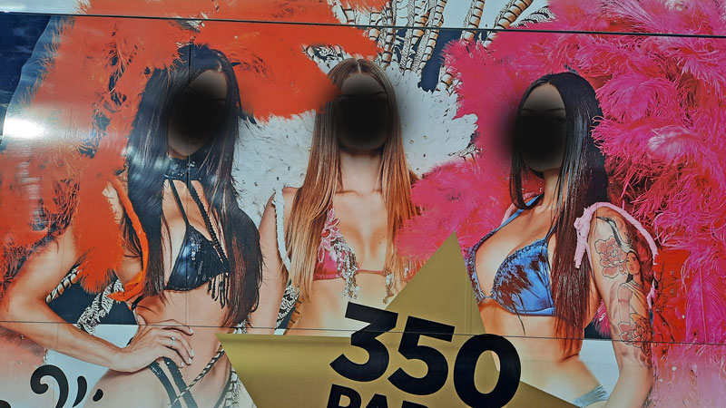 Prague Red Light District advert for a cabaret performance with three scantily clad girls and lots of ostrich feathers