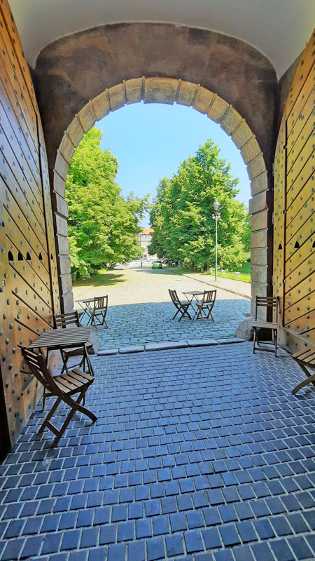 a view looking back through the sand gate fortification in prague to what was outside of the city in 1750