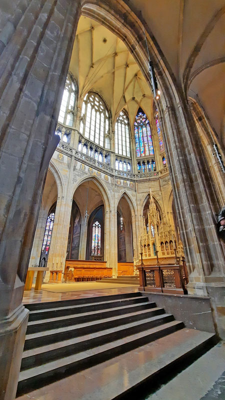 showing the view from the prague st vitus cathedral royal tomb area up to the top of the nave