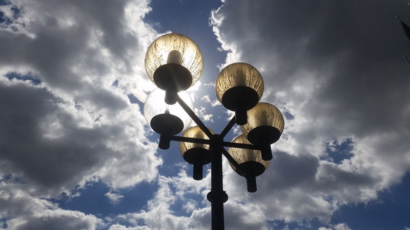 old town square prague new style street lamps with dramatic blue sky and cloud background