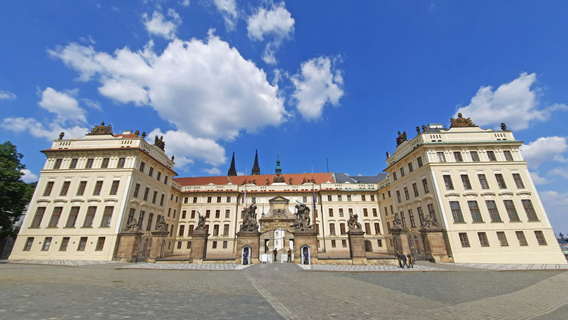 prague castle scene view of the first courtyard entry viewed from the square with no tourists
