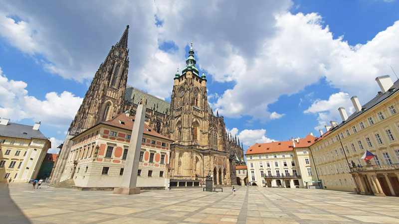 prague castle third courtyard showing st vitus cathedral, old royal palace, obelisk and office of the president