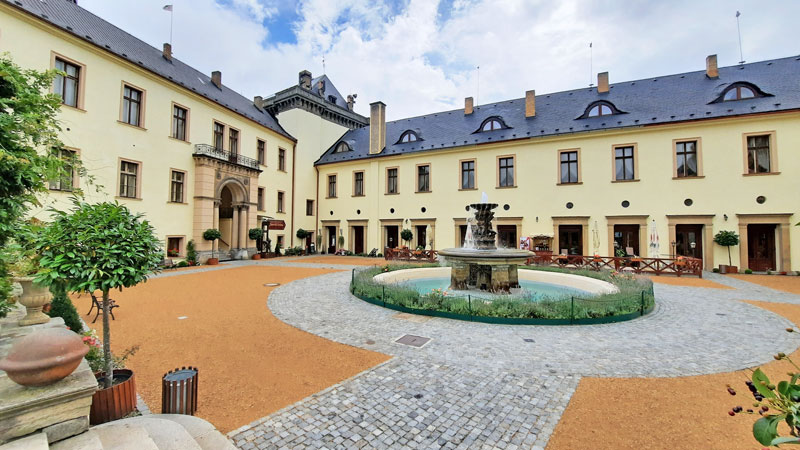 the courtyard of zbiroh castle and entry to the castle pub.