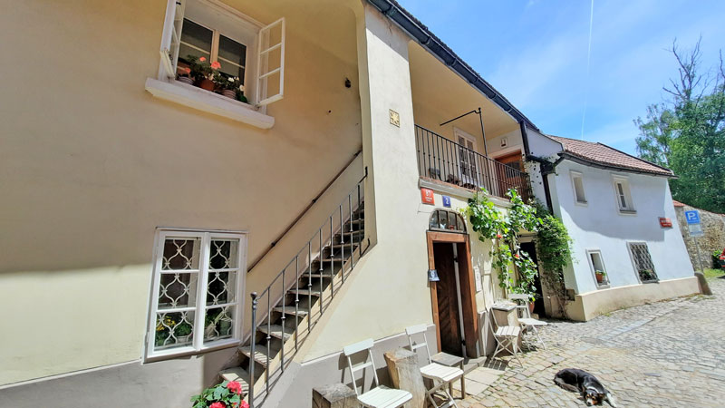 the golden star house and cafe in a prague street called nový svět